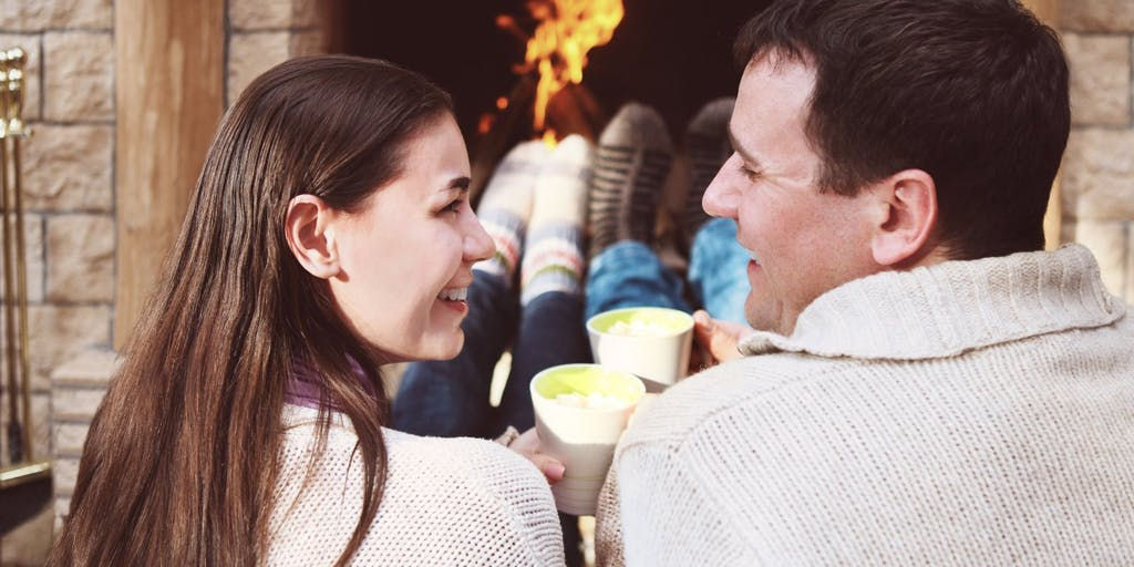 happy-couple-infront-of-fire