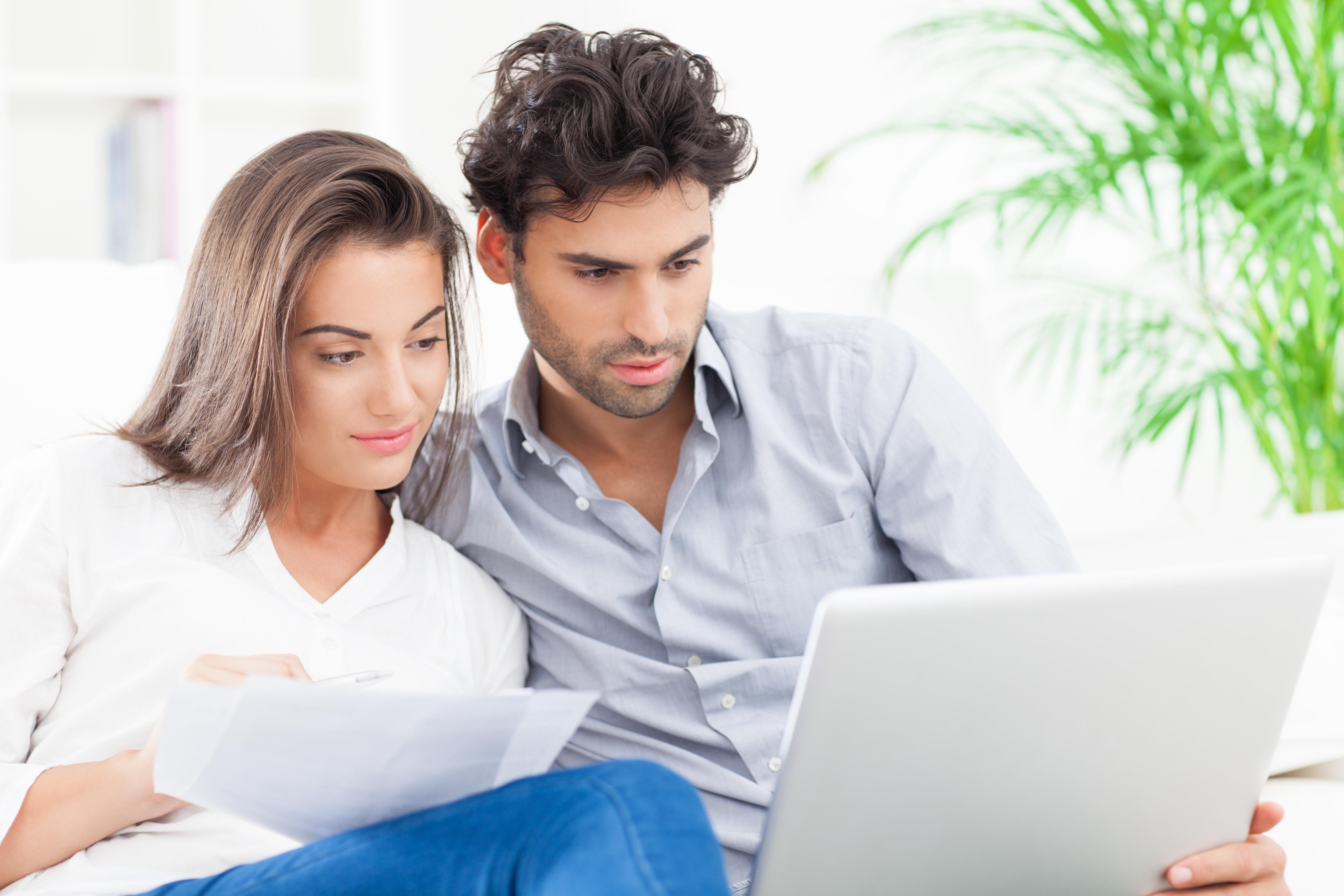 Young couple reading utility bill