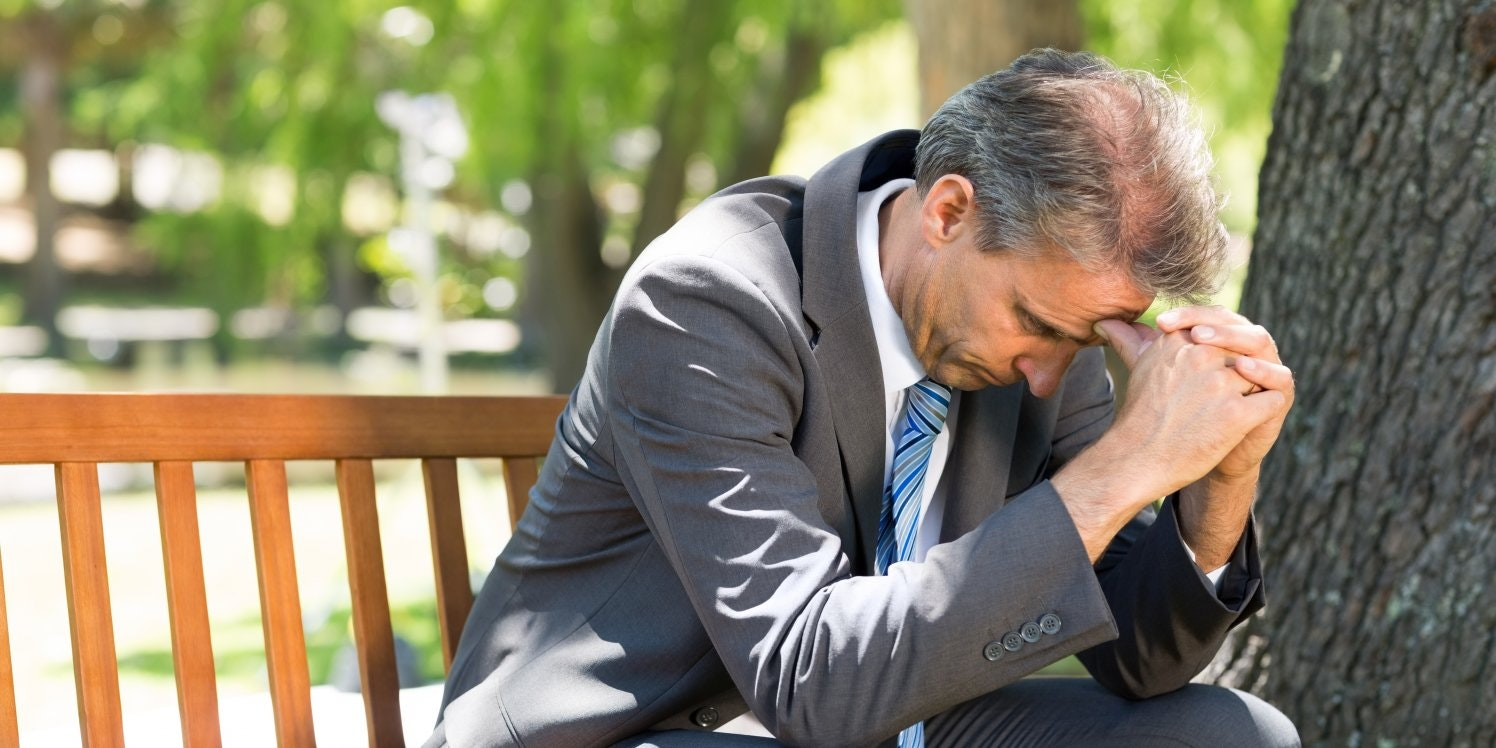unhappy-businessman-in-park