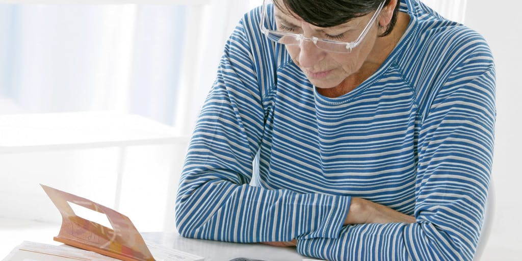 woman-with-calculator-and-paperwork