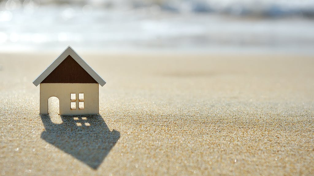 little house on the sand beach near sea