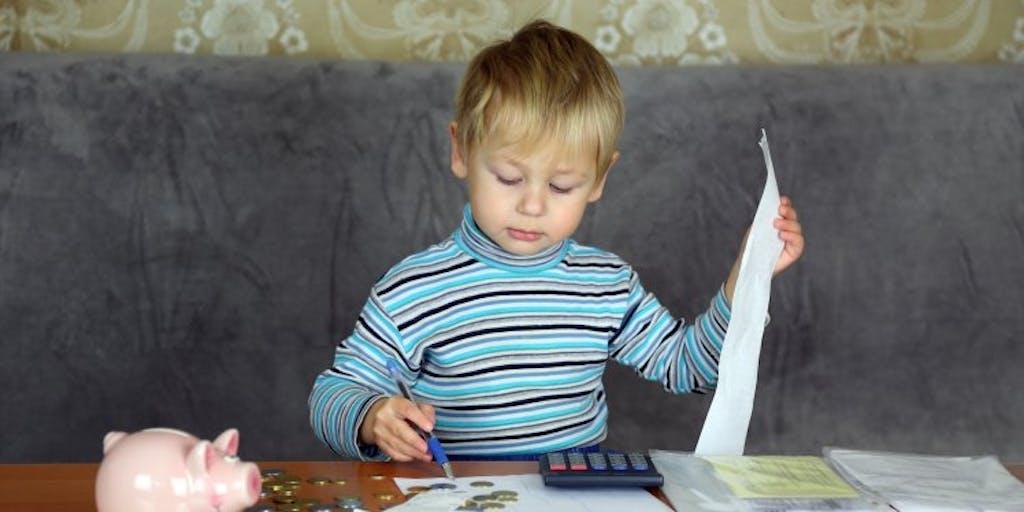 child-calculator-piggy-bank-and-paperwork.