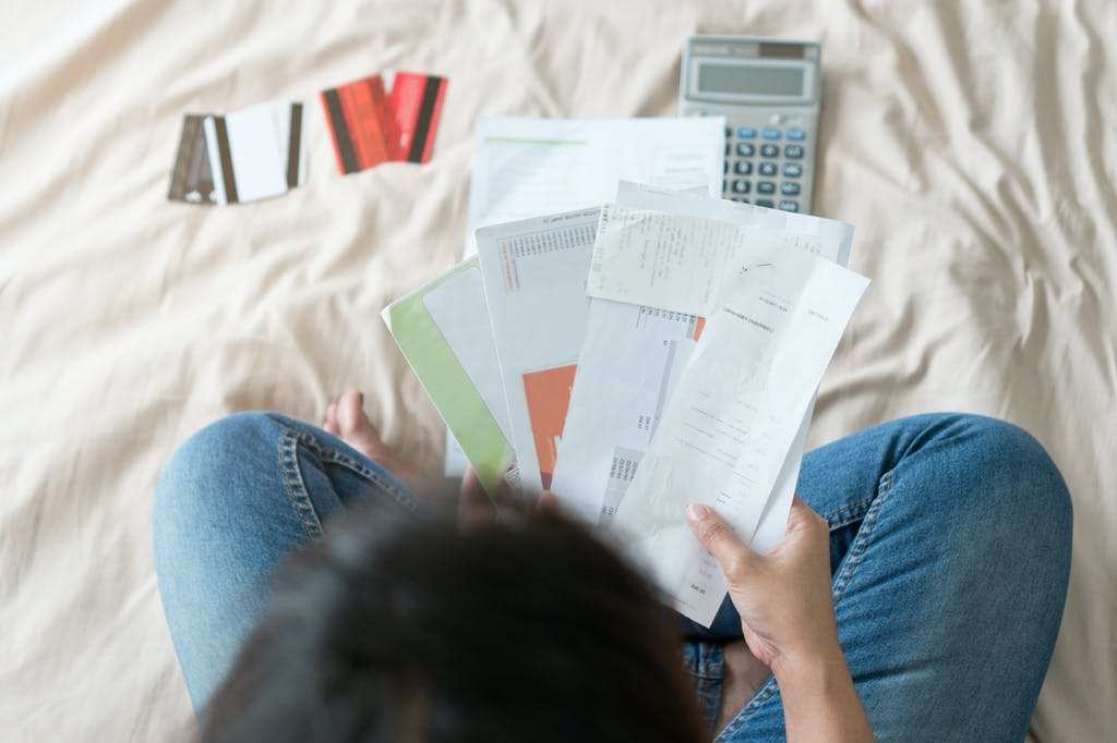Person worried about debt looking at bills