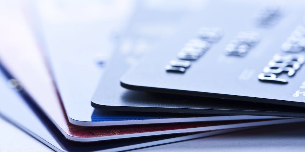 A picture of 5 credit cards stacked on top of each other