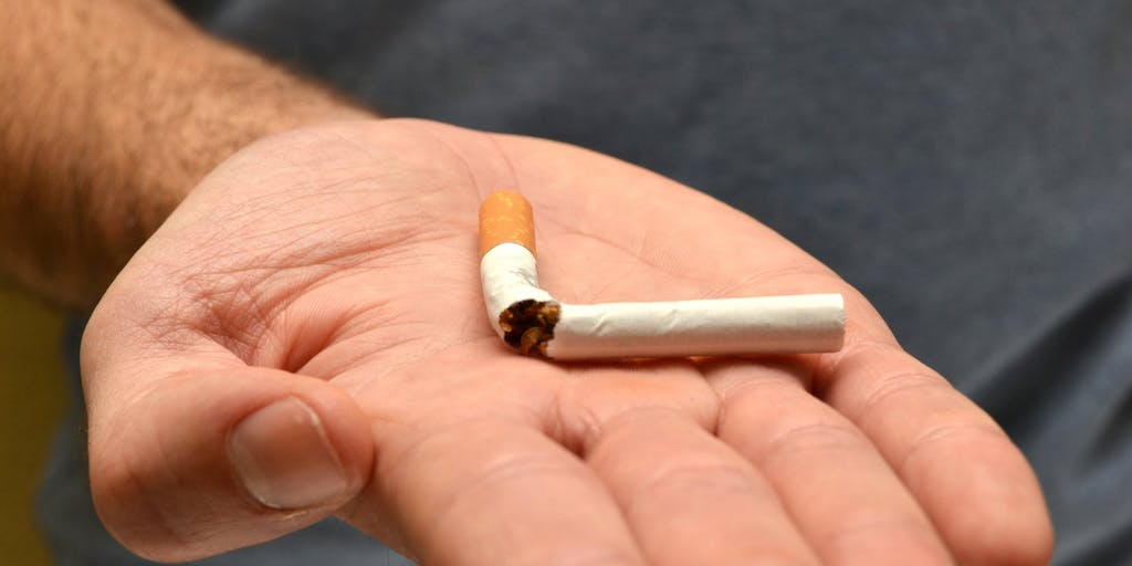 Open palm with broken cigarette