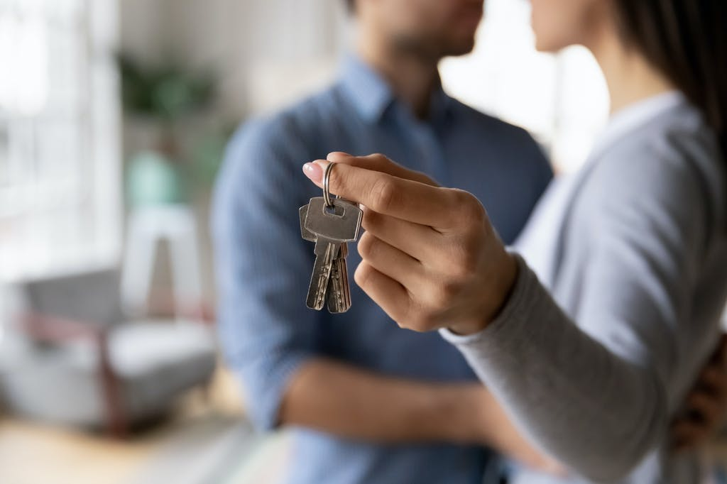 Couple with keys to rented house