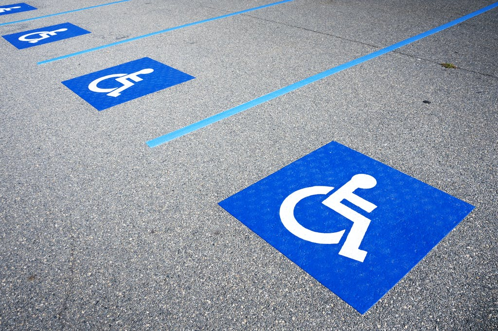 Parking reserved for disabled drivers blue badge carpark