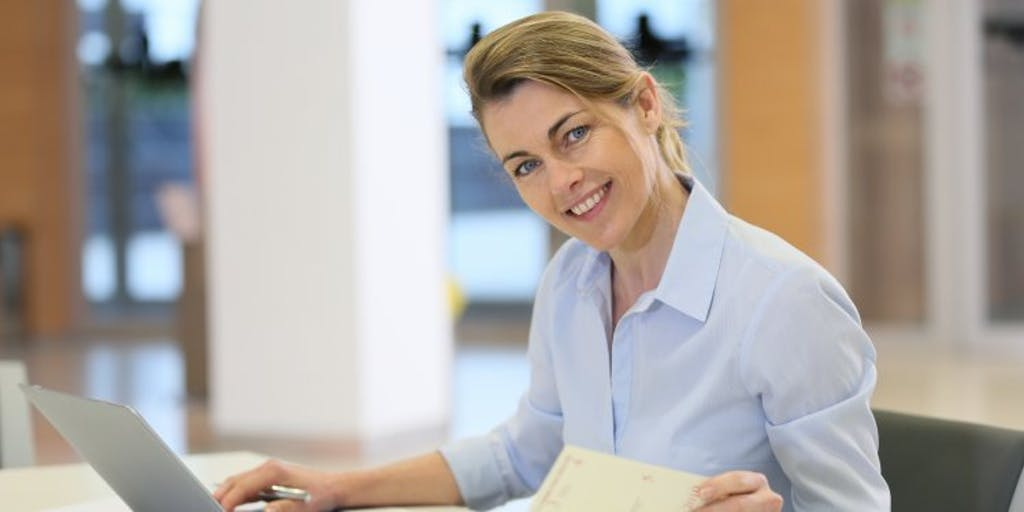 woman-at-desk-with-laptop-and-paperwork