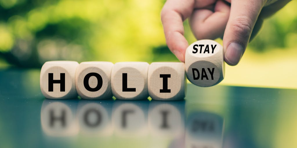 """image of cubes spelling out """"holi"""" in separate cubes, followed by the word """"stay"""" on another cube to represent a staycation"""