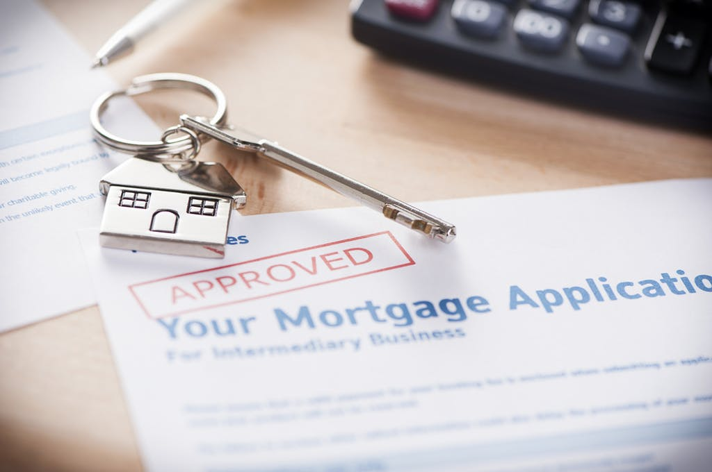 The 95% LTV mortgage guarantee scheme - mortgage application with 'approved' stamp