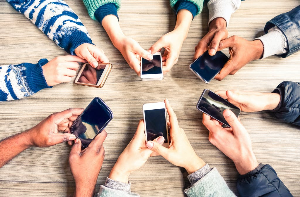 People holding mobile phones