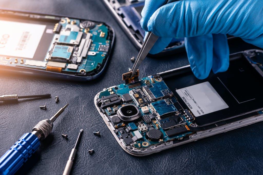 Technician fixing a phone