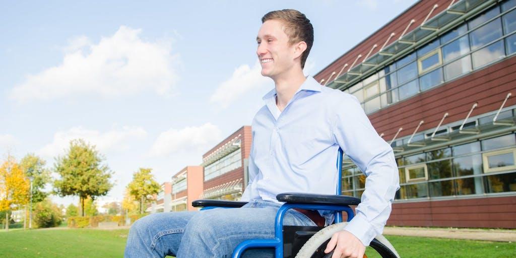 Man in wheelchair smiling
