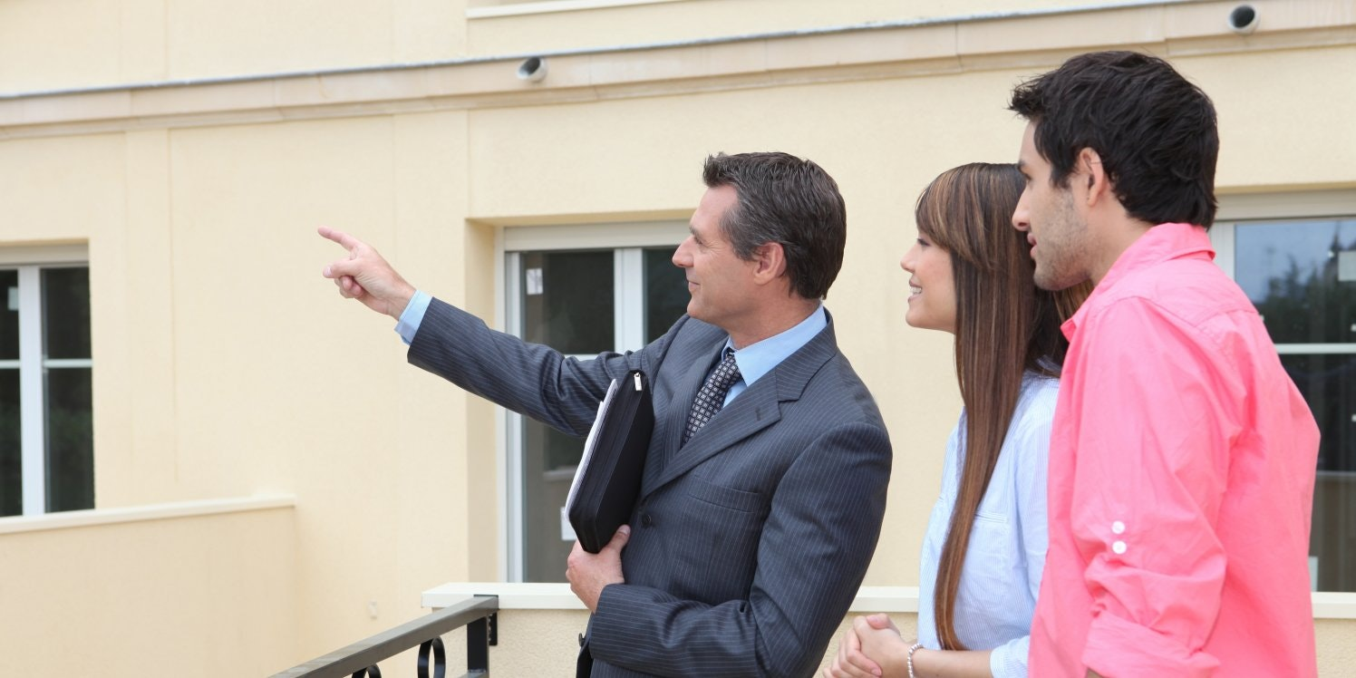 Agent showing property to new couple