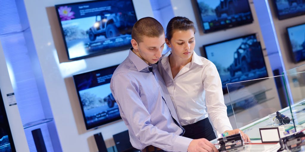 Couple browsing in electronics store
