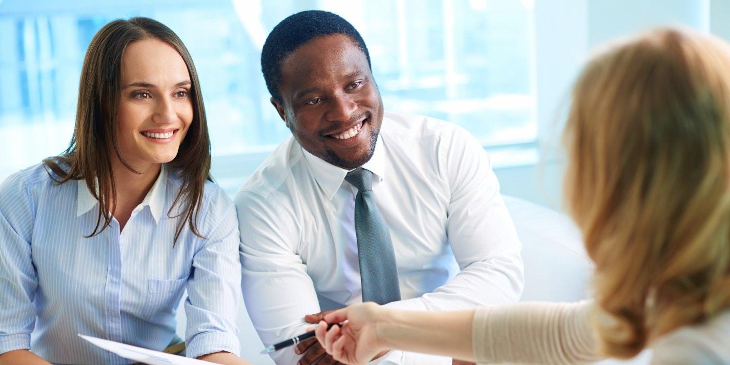 Happy couple with advisor