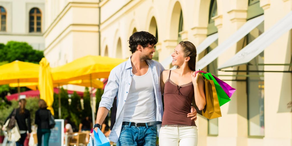 Couple with shopping bags walk on the street