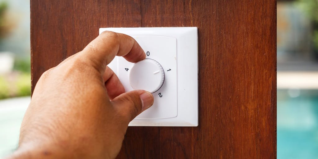 Person using thermostat