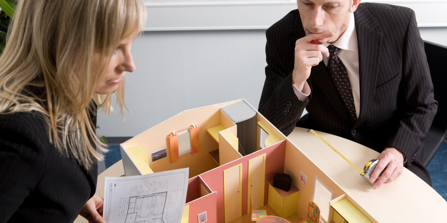 two people looking at property plans