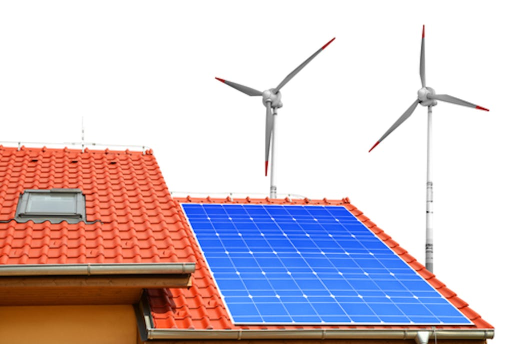 House with solar panels and wind turbine
