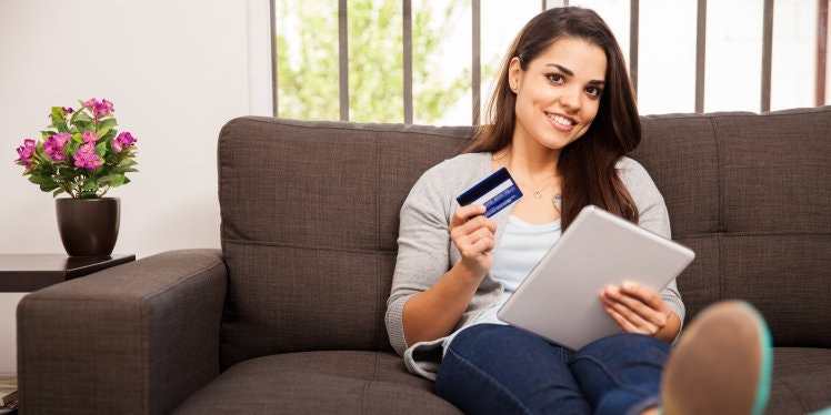 woman-tablet-credit-card-sofa
