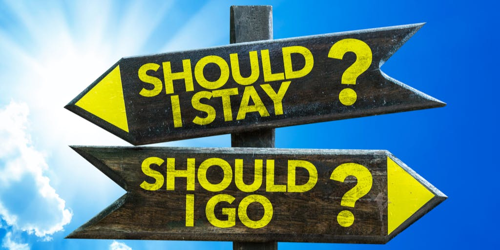 Signs pointing in different directions saying should i stay or should i go