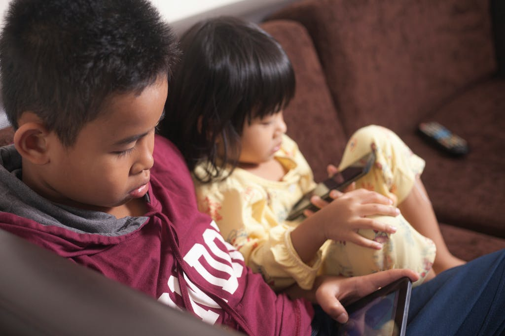 Kids using mobile phones and tablets