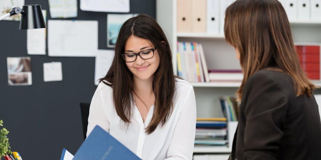 businesswoman-interview-desk-documents-cv