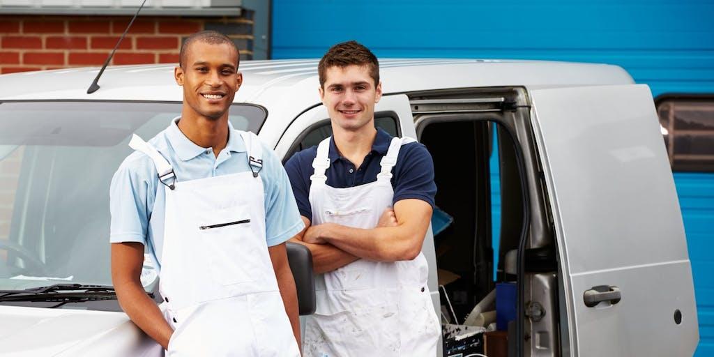 two men outside van