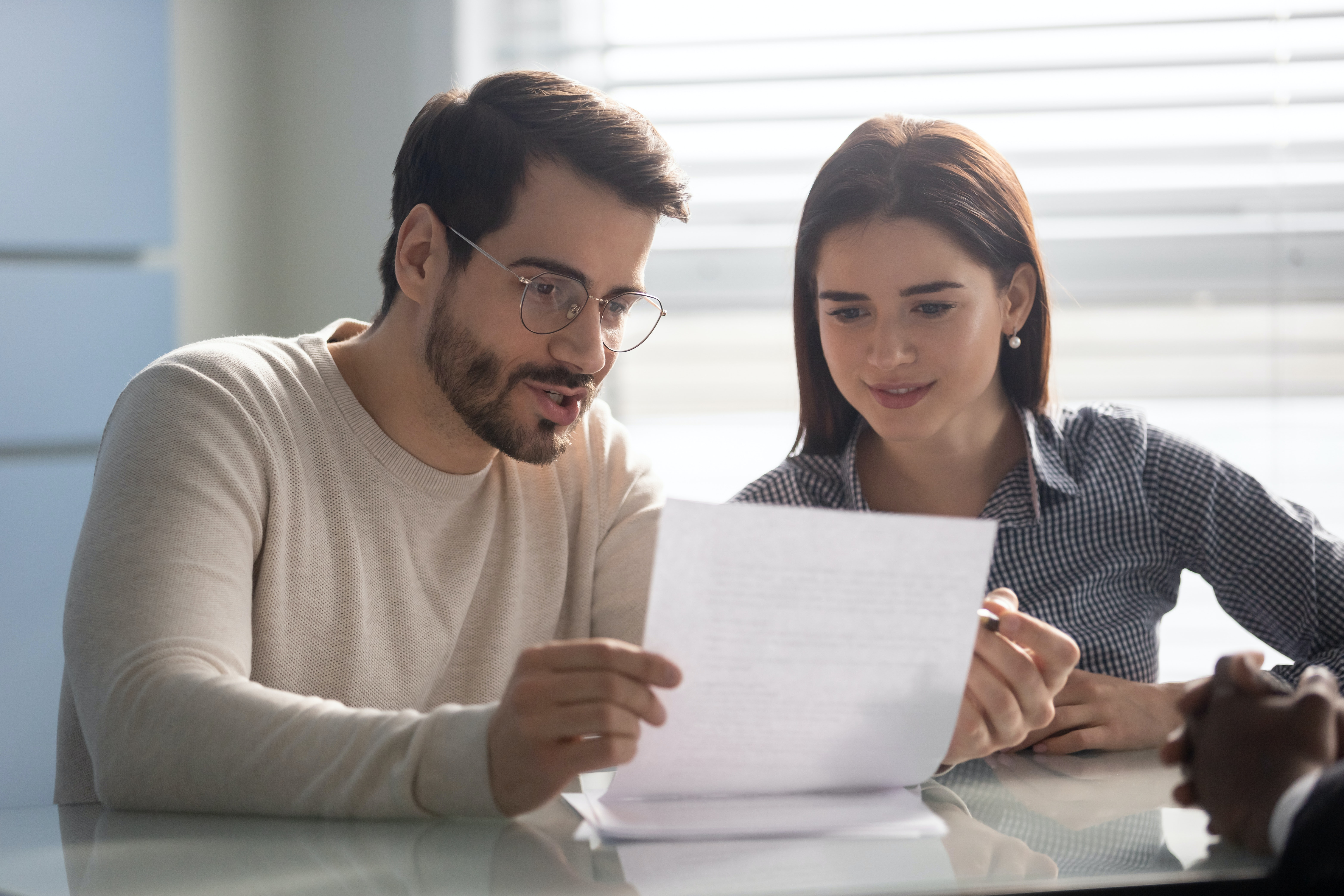 Couple looking at contract containing their broadband consumer rights
