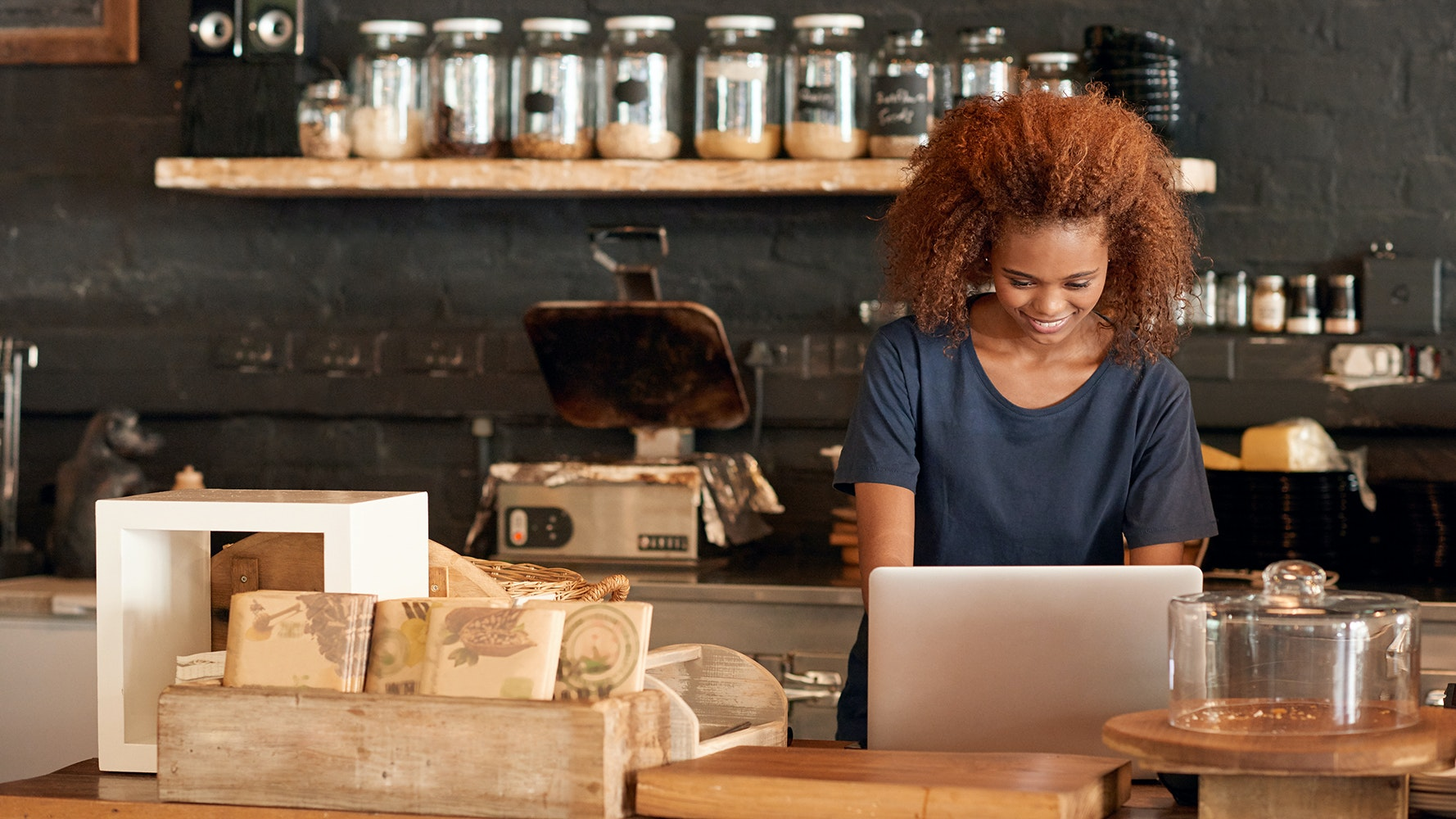woman in cafe working on laptop