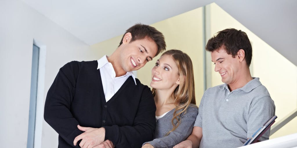 Couple with real estate agent in new home