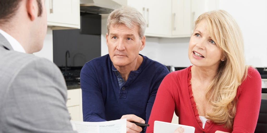 Concerned couple with advisor