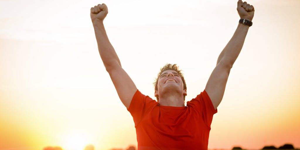 man-celebrating-winning-runner