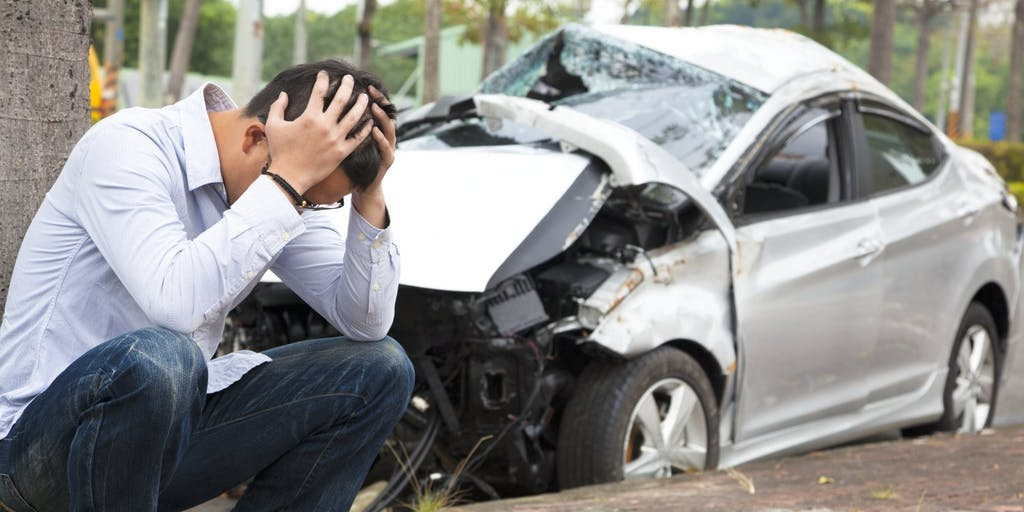 driver-upset-after-car-crash