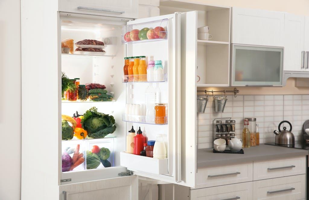Open fridge in kitchen