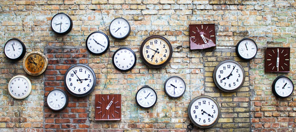Clocks hanging on a wall