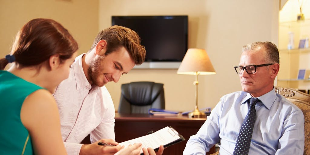 Financial adviser with young couple
