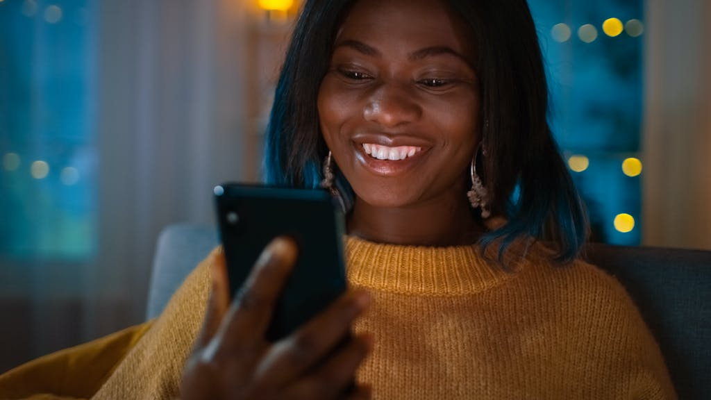 Girl using phone with eSIM card