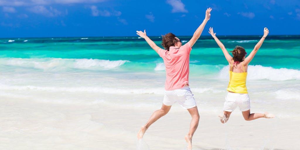 Couple on beach jumping