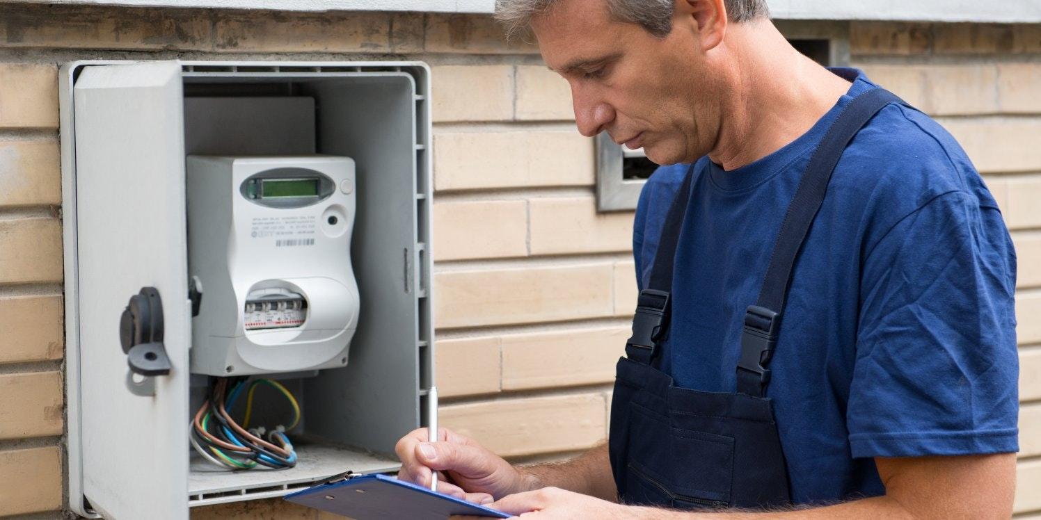 Serviceman checking an energy meter