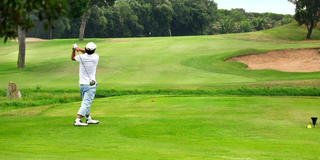 man-hitting-golf-shot