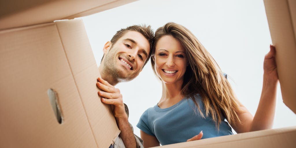 Couple looking into a cardboard packing box