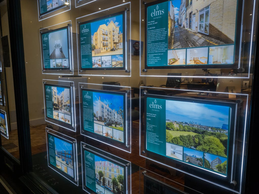 A wall of property listings