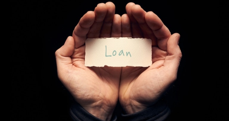Open hands holding a label with the word loan