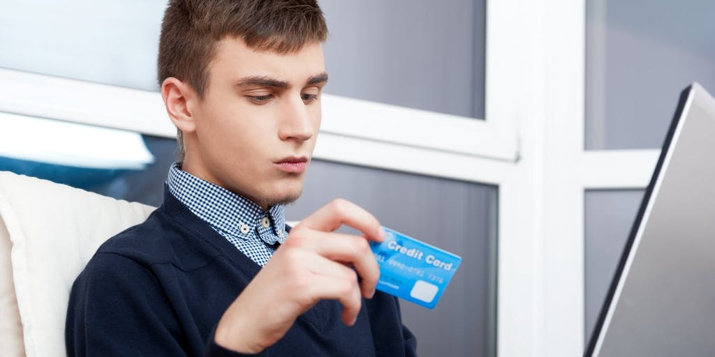 Young man shopping online