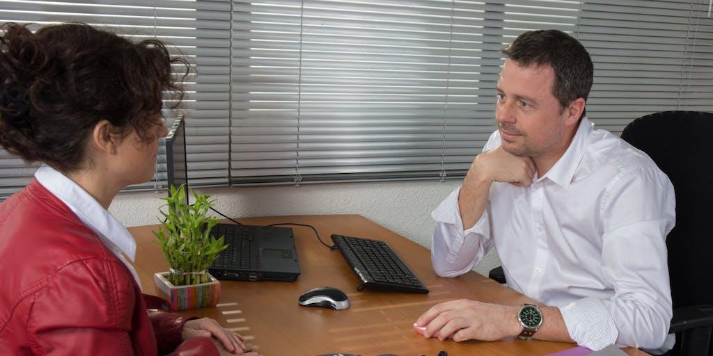 woman and man at desk