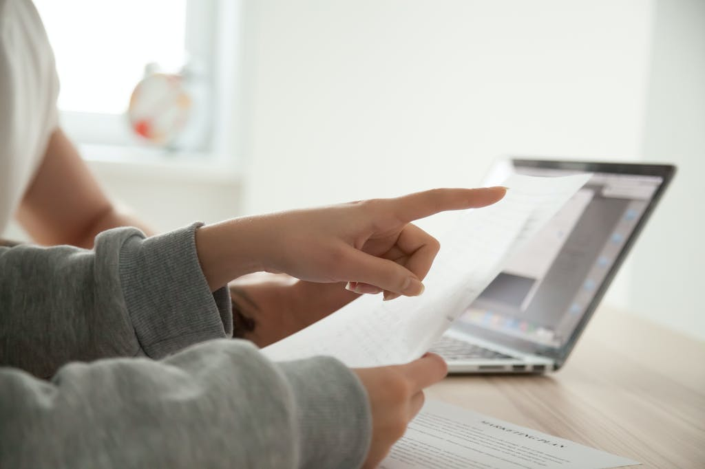 Person pointing at terms and conditions document