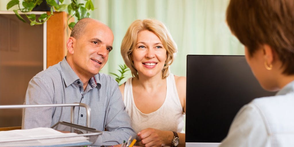 Older couple with financial advisor