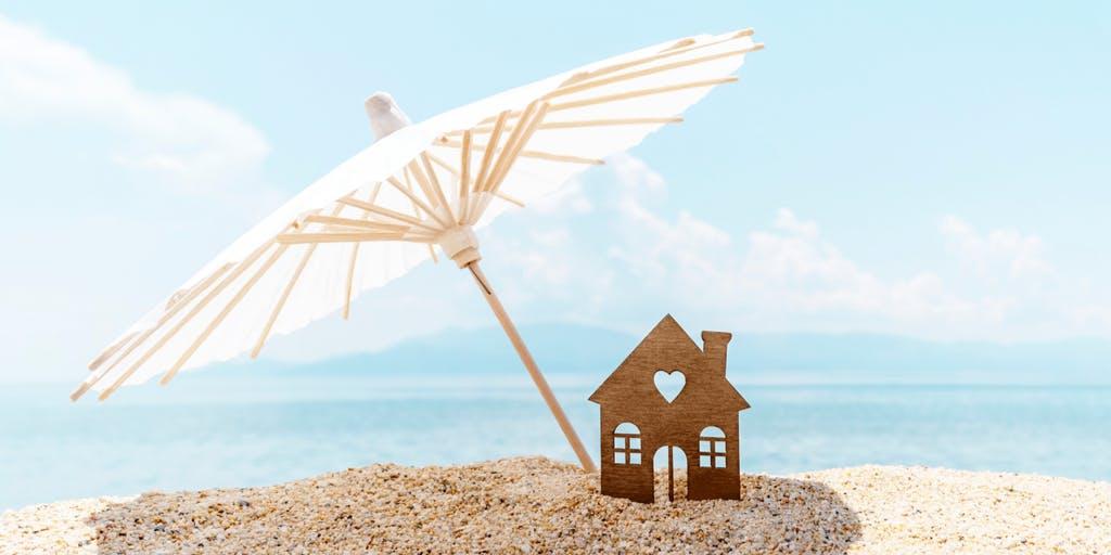 Image of model house under umbrella